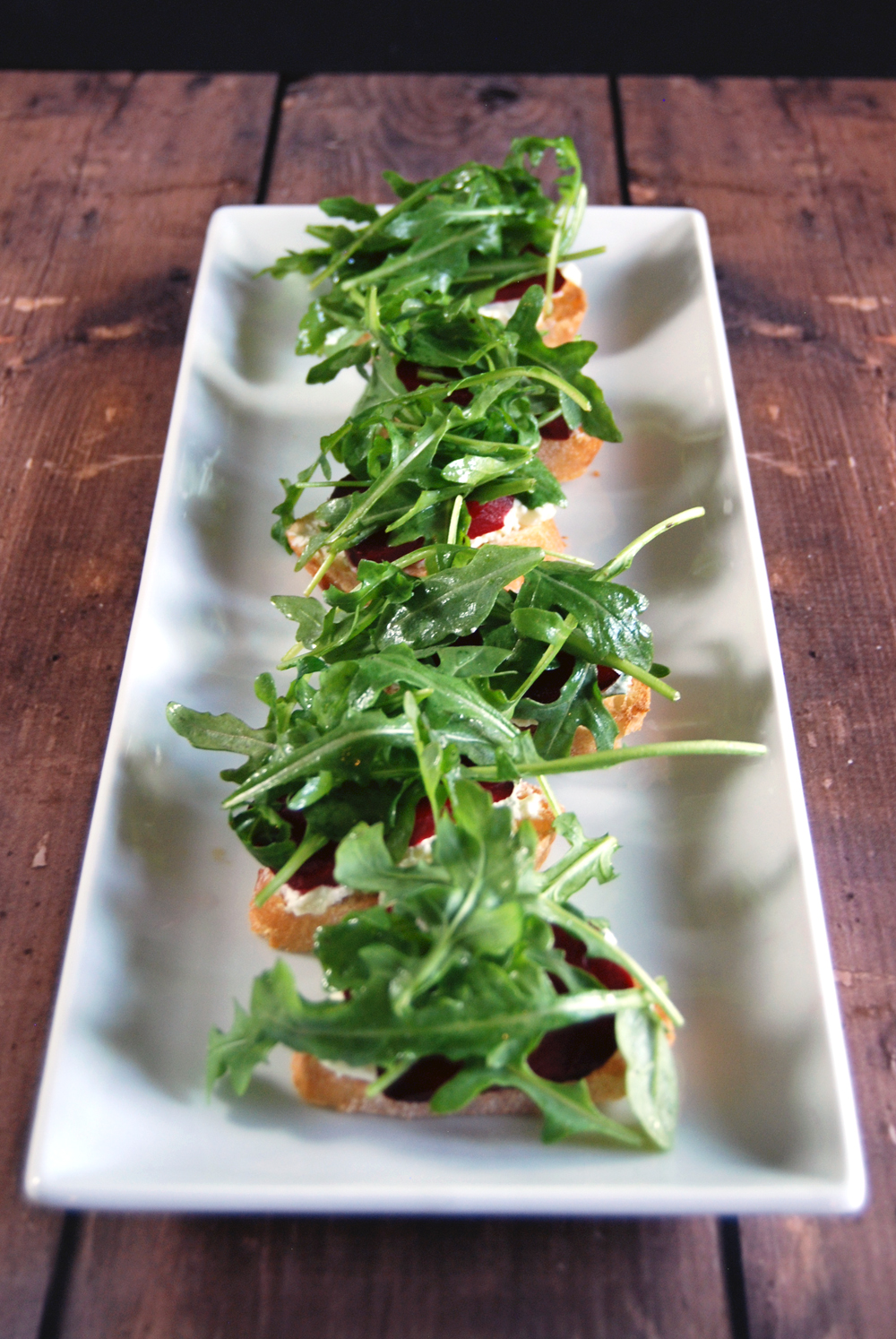 Herbed Goat Cheese Crostini with Roasted Beets and Arugula