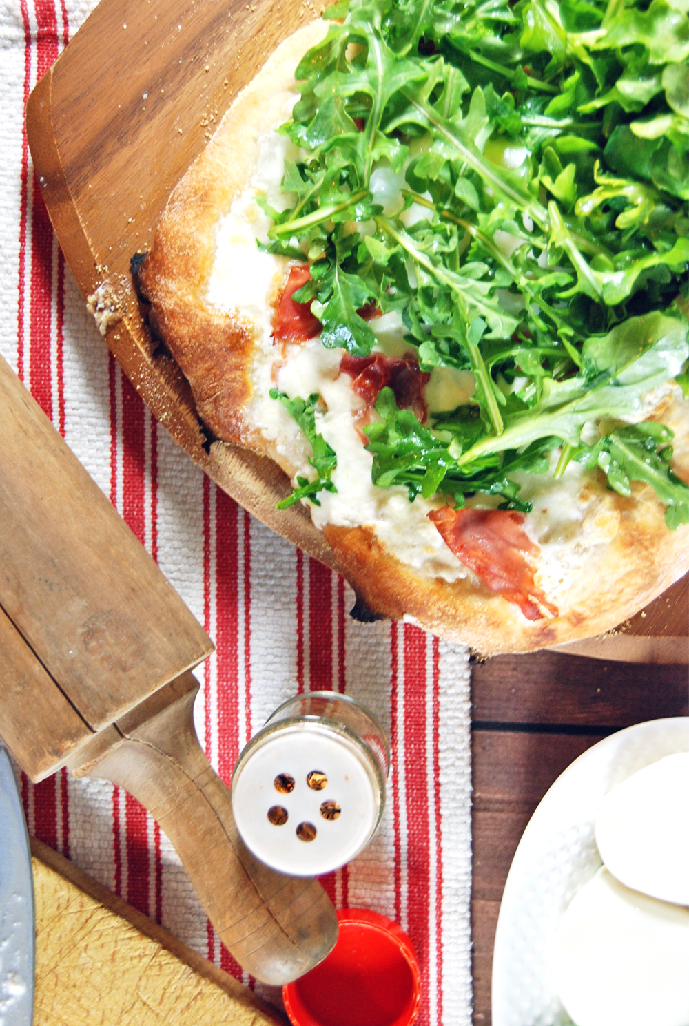 Prosciutto and Burrata Pizza with Poached Eggs and Arugula