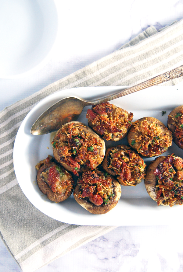 Cheesy Prosciutto and Garlic Stuffed Mushrooms: These stuffed mushrooms feature roasted garlic, crispy prosciutto, and a blend of parmesan and asiago cheese.