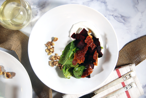 Oven Roasted Beet Salad with Goat Cheese Crema and Crispy Prosciutto: Hearty oven roasted beets are paired with a creamy goat cheese sauce, lightly dressed spring greens, toasted walnuts, and broiler-crisped prosciutto.