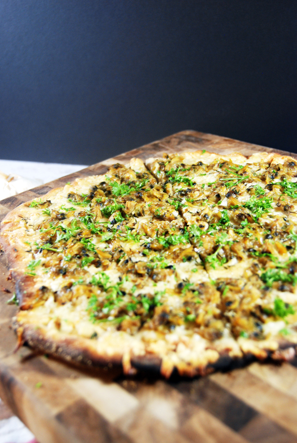White Clam Pizza: Delicious plump clams on a pizza, paired with asiago and parmesan cheese and fresh thyme and parsley.