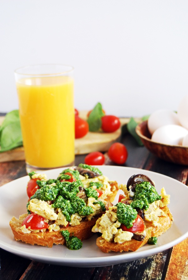 Scrambled Egg Breakfast Toasts with Mushrooms, Cherry Tomatoes, and Spinach Pesto