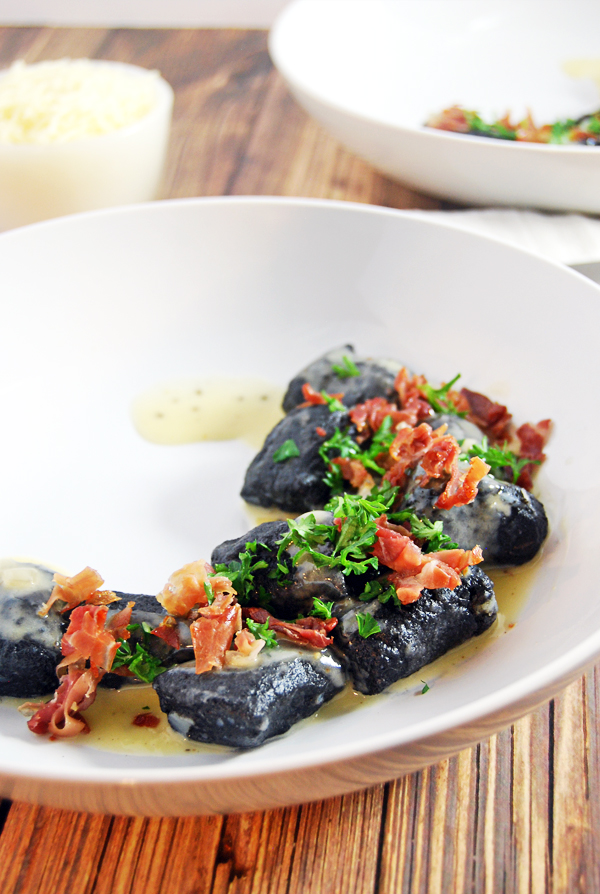 Squid Ink Gnocchi with Champagne Beurre Blanc and Crispy Prosciutto: Classic Italian gnocchi are elevated a notch with the use of squid ink, then paired with a beautiful champagne beurre blanc and crispy prosciutto bits.