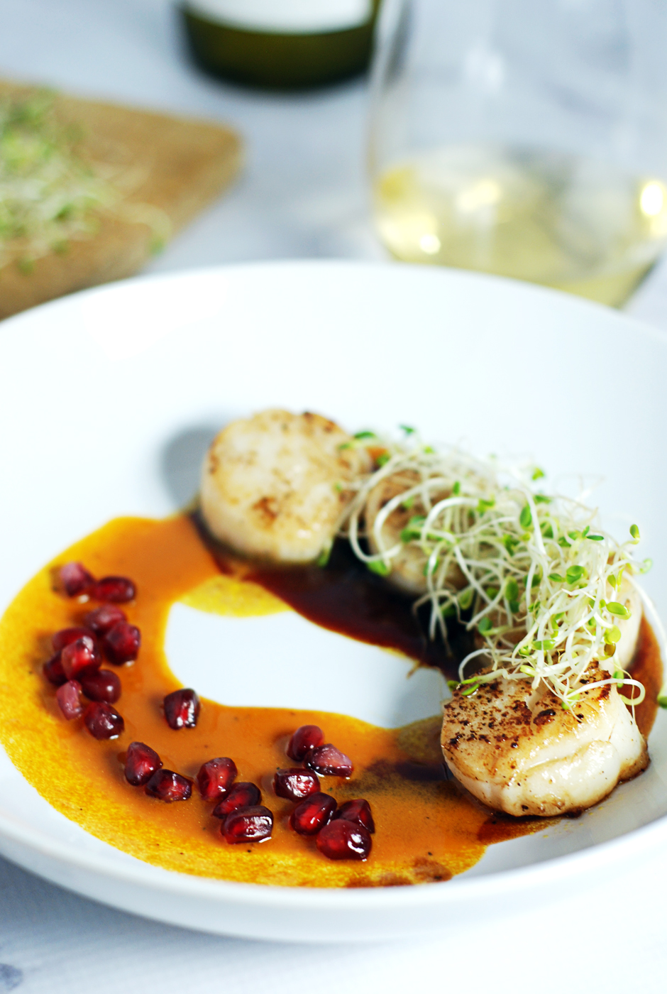 Seared Scallops with Duo of Pomegranate and Carrot Sauce