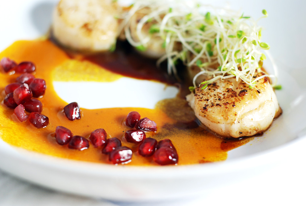 Seared Scallops with Duo of Pomegranate and Carrot Sauce: Delicious easy seared scallops are paired with a duo of pomegranate and carrot sauces in this simple yet elegant dish.