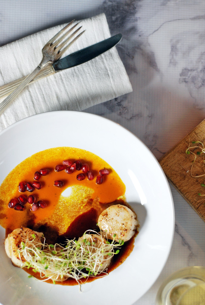 This delicious recipe for easy seared scallops is paired with a duo of beautifully refreshing pomegranate and carrot sauces.