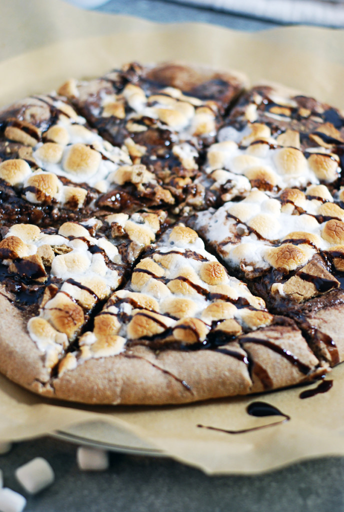 Whole Wheat S'Mores Dessert Pizza: You won't want to put a slice of this pizza down! S'mores are the star of this pizza, which features Nutella spread, graham crackers, marshmallows, and chocolate sauce.