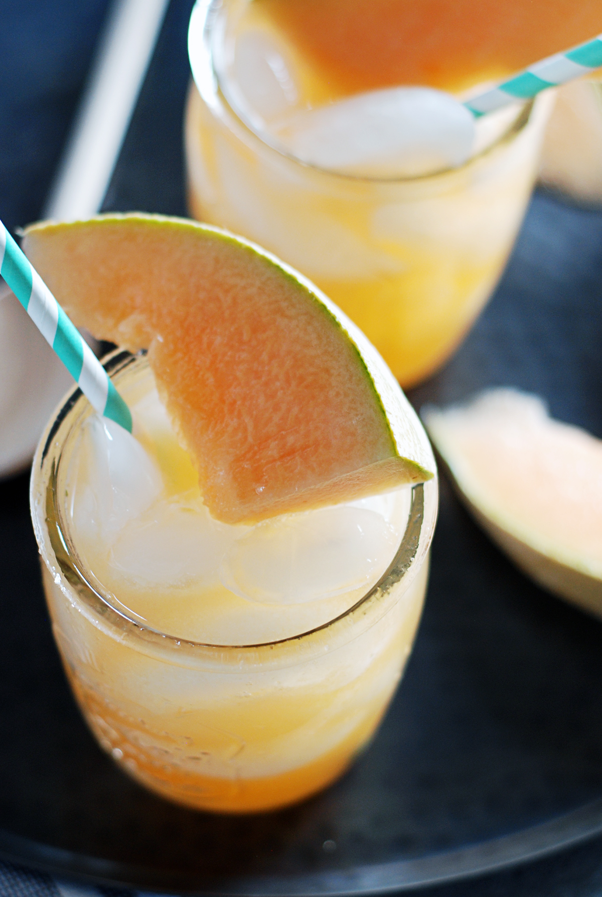 These rum and cantaloupe cocktails are crazy refreshing, and feature fresh melon juice, agave nectar, rum, and mint!