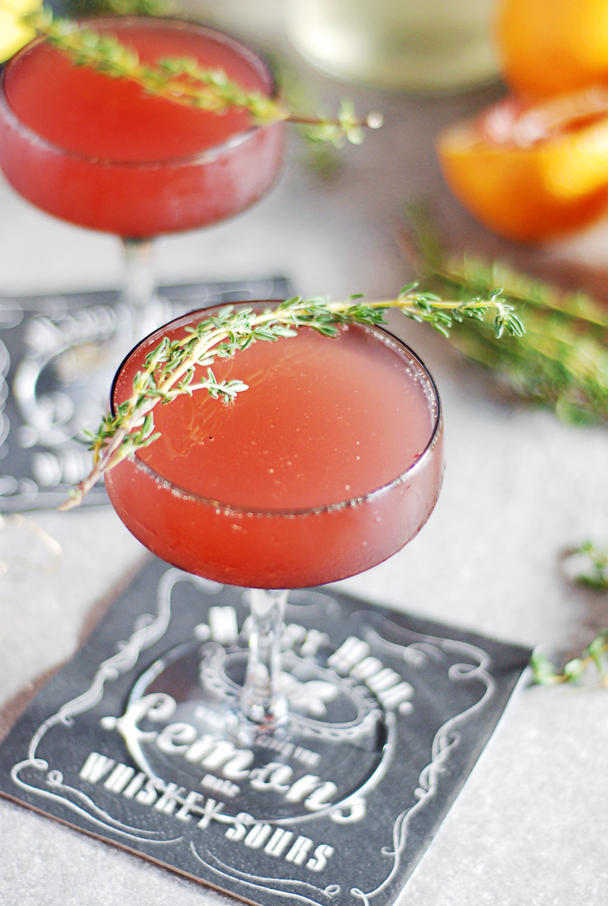 These blood orange mimosas are a beautiful twist on a classic brunch cocktail, and feature thyme simple syrup and gin.
