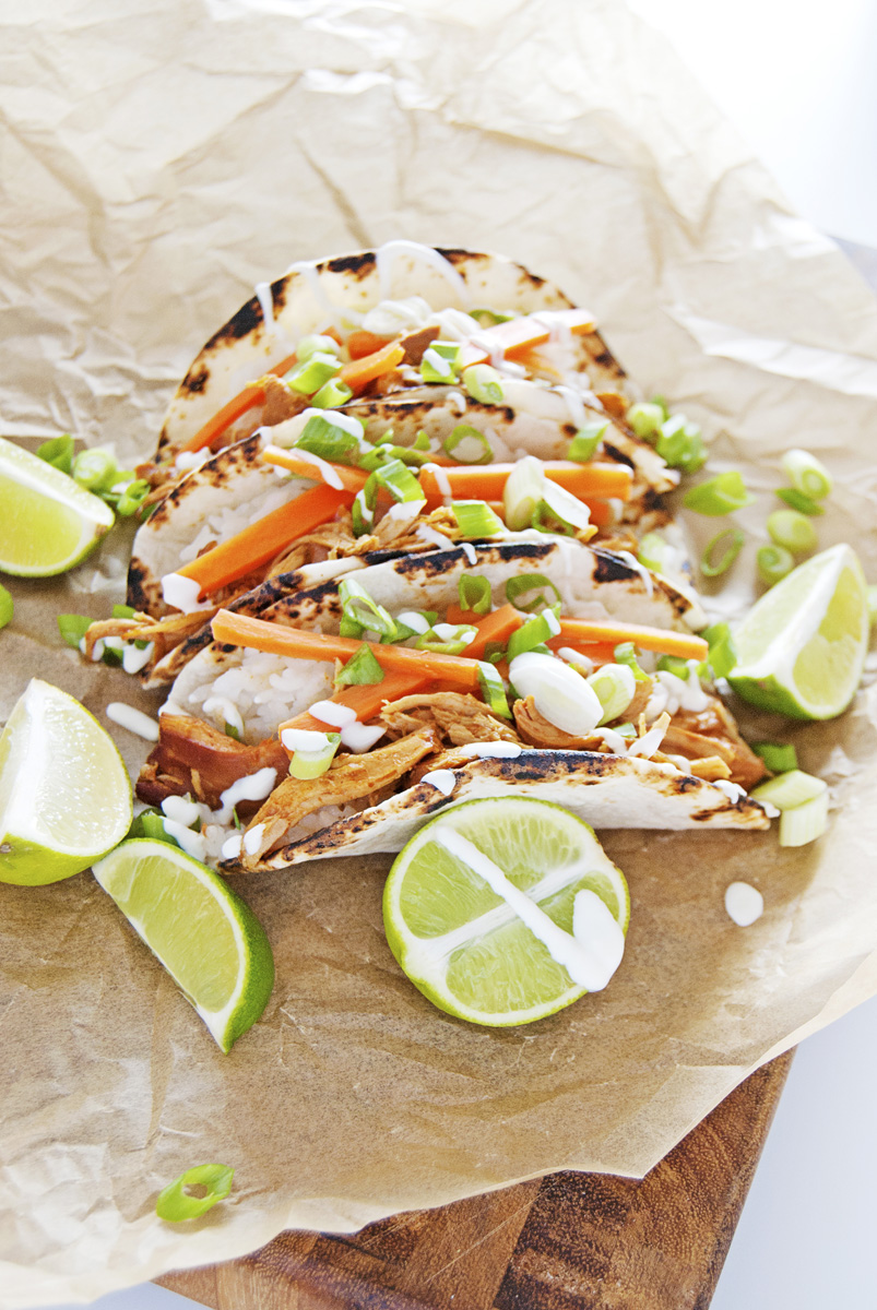 These slow cooker asian chicken tacos really pack a flavor punch, with beautifully bold Asian flavors of hoisin, ginger, and garlic, and more!