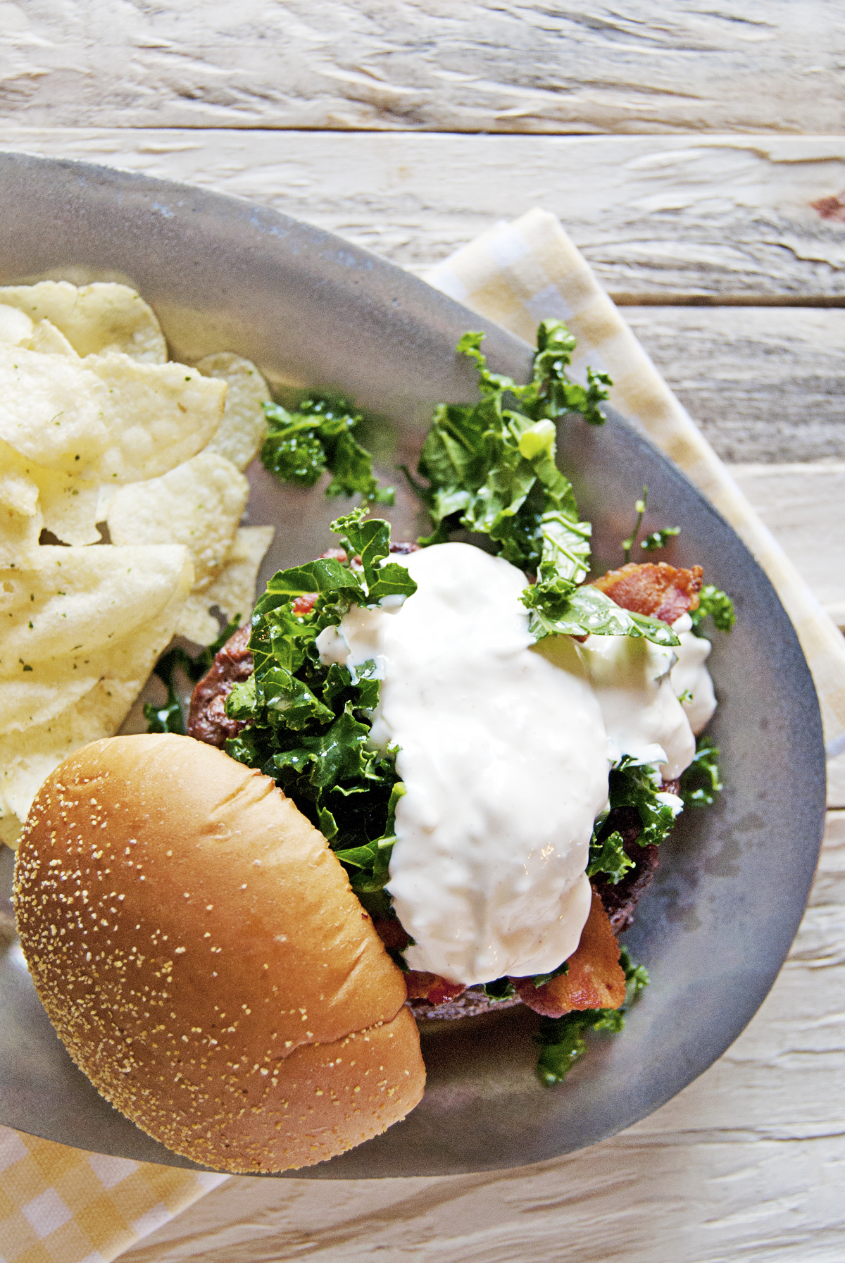 These tasty ancho chili burger are paired with a macerated kale slaw and a creamy goat cheese ancho mayo!