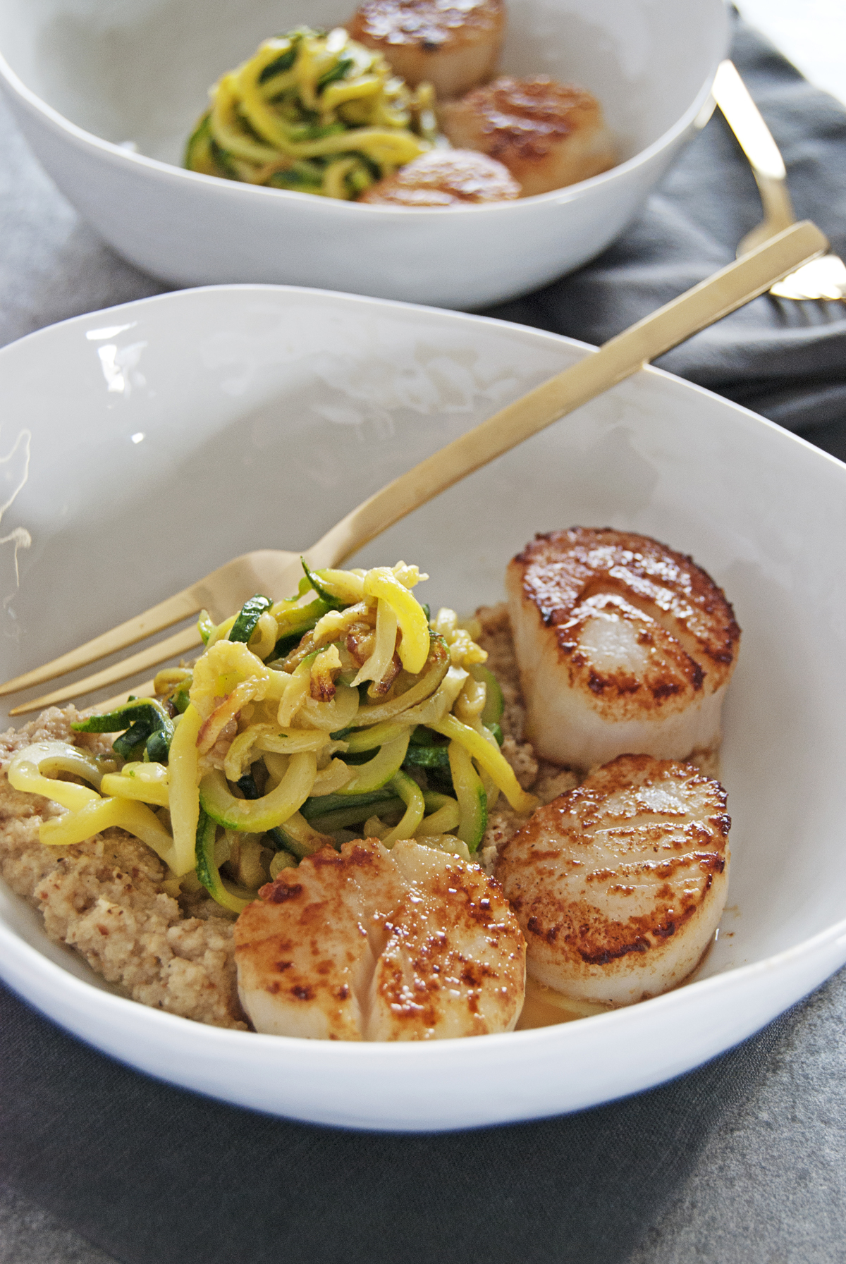 These beautiful seared scallops are paired with a tasty roasted cauliflower pesto and fresh zucchini noodles.