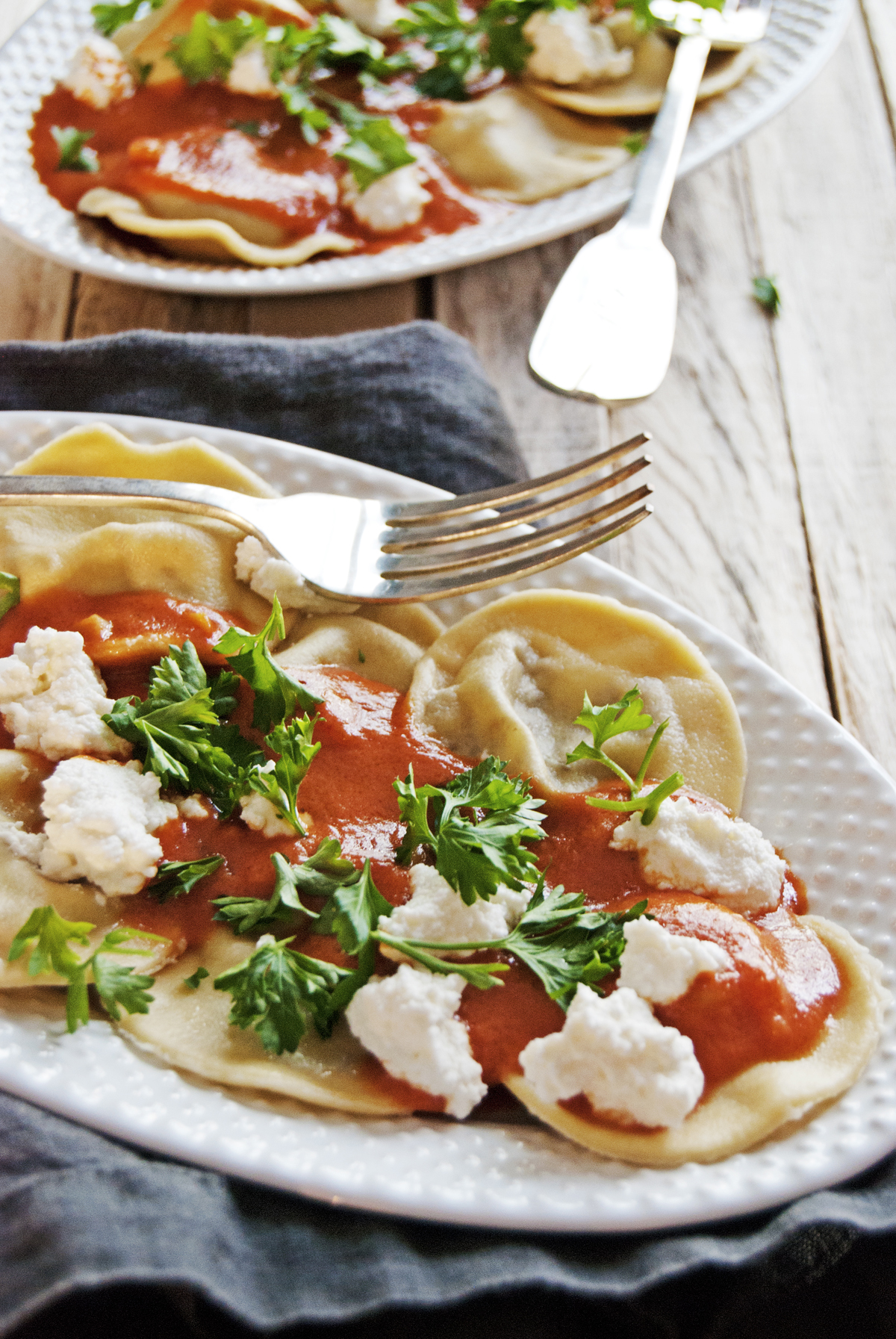 These tasty beef ravioli are filled with a delicious ground beef filling topped with the creamiest tomato sauce you've ever had and lots of fresh ricotta!