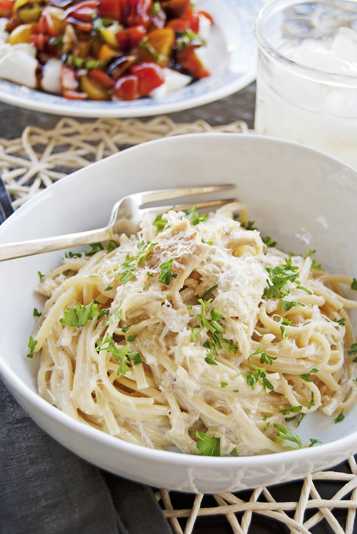 This creamy garlic chicken pasta features shredded seasoned chicken with linguine tossed in a super creamy and super garlicky sauce!
