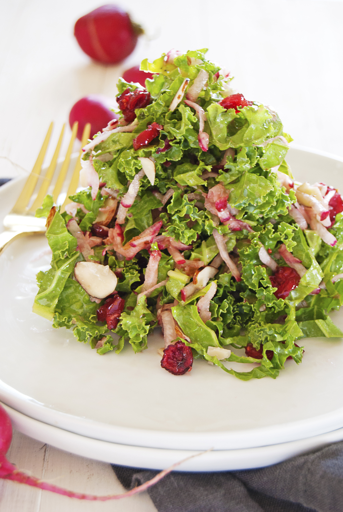 This refreshing kale and radish slaw features shredded kale and radish paired with slivered almonds, dried cranberries, and a refreshing vinaigrette.
