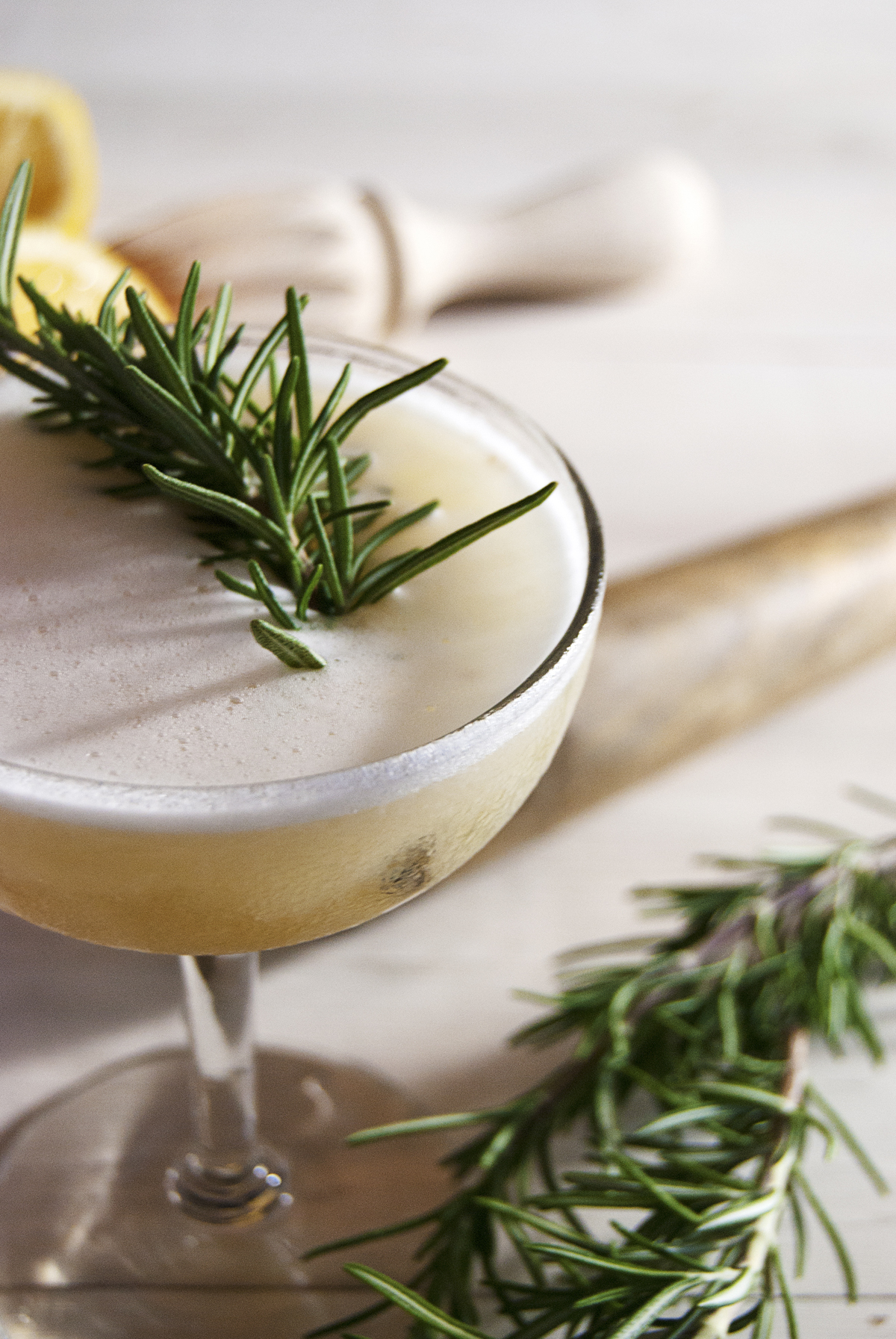 This gorgeous fig cocktail features fig jam paired with rosemary and pisco liquor.