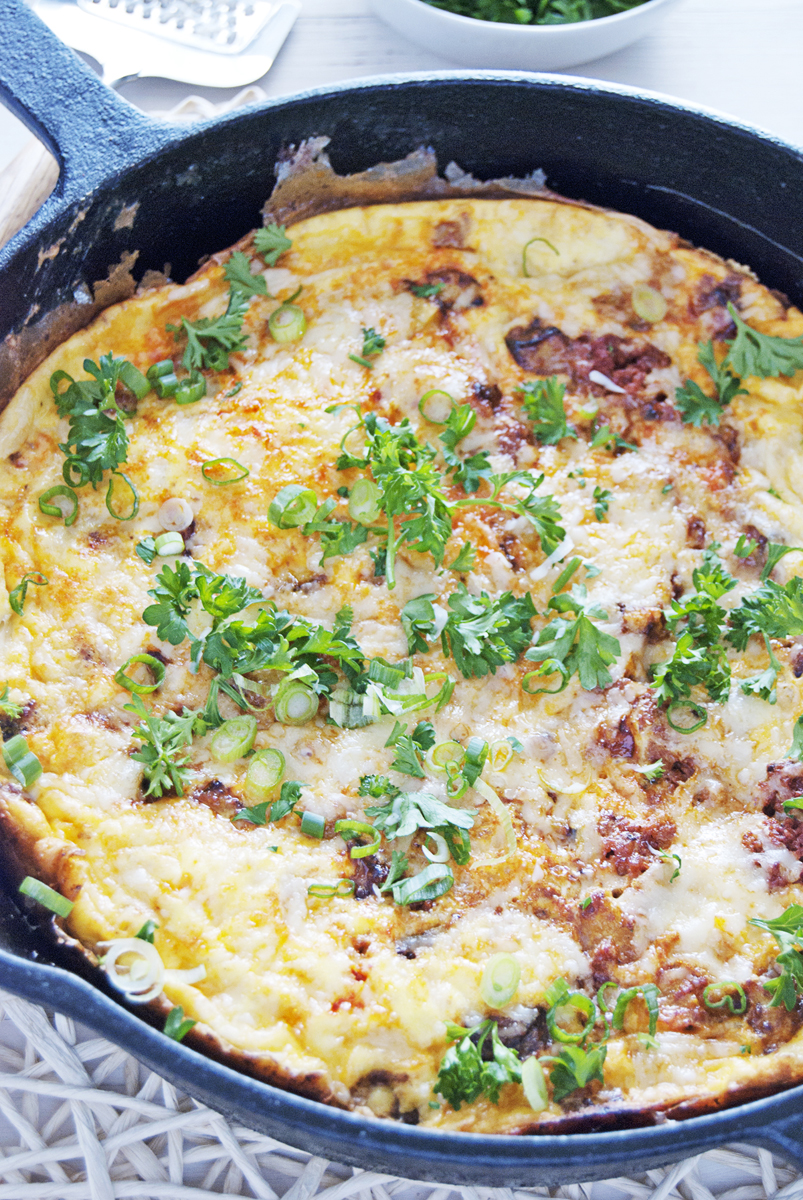 This beautiful chorizo and butternut squash frittata is paired with gruyere is the perfect Sunday morning breakfast!
