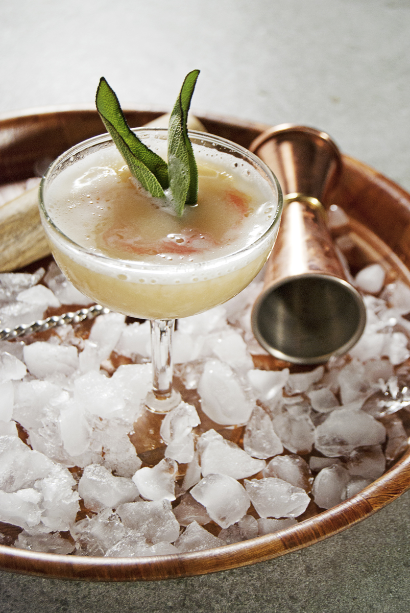 This beautiful smoked sage cocktail features hearty bourbon and a ginger sage simple syrup, and a light char on the sage before presentation gives a beautifully smokey aroma.