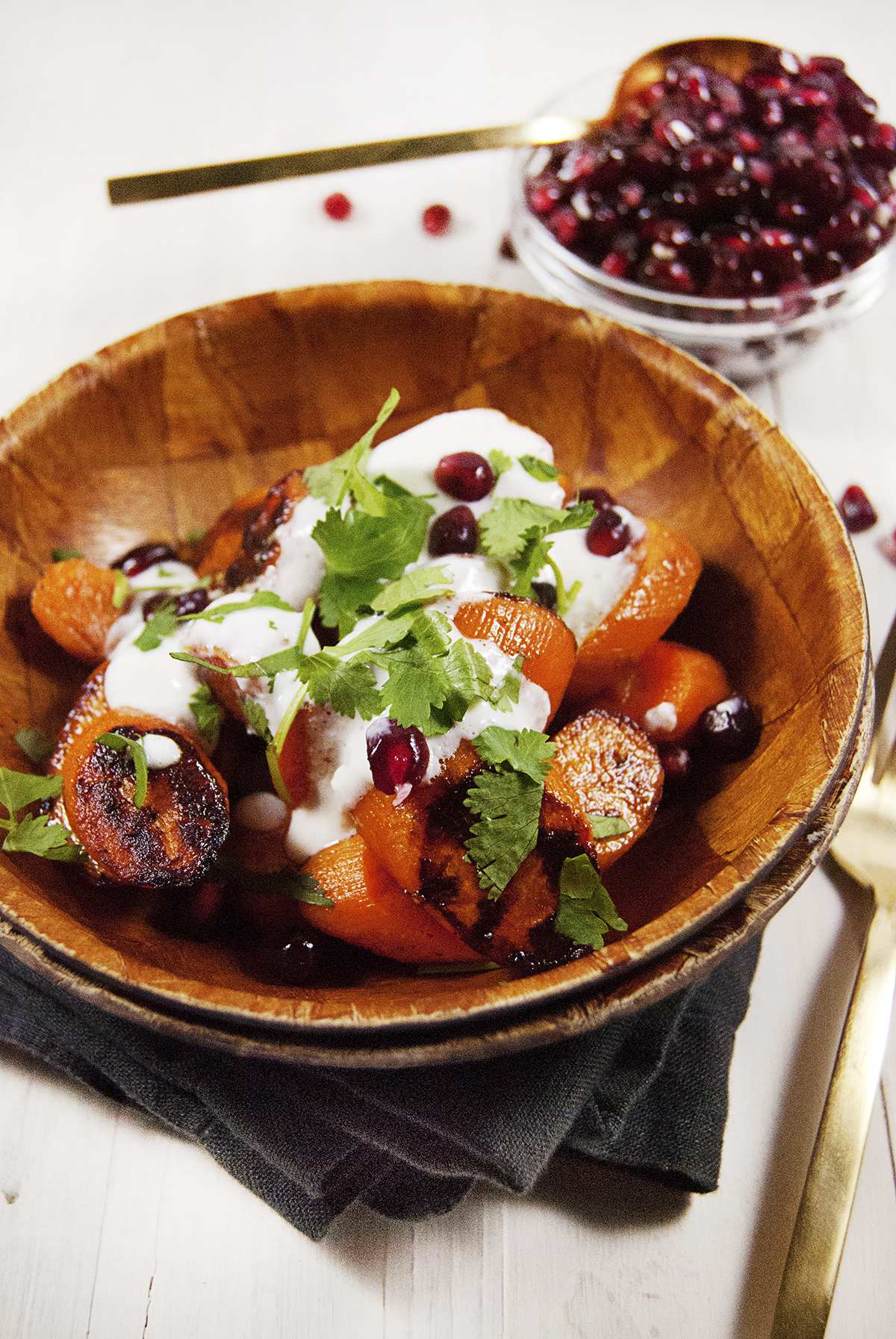 These crunchy roasted carrots are paired with a light cotija cream, fresh cilantro and pomegranate seeds.