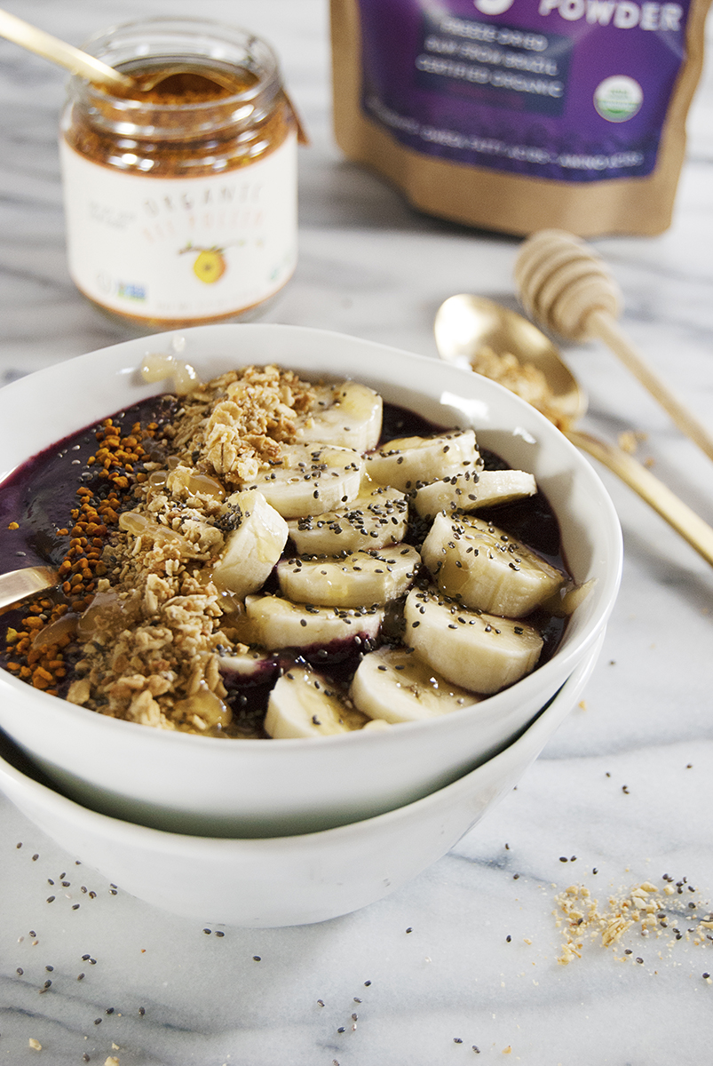 These tasty acai bowls with granola and bananas are a refreshing and healthy snack, and are topped with all sorts of goodies, including bee pollen!