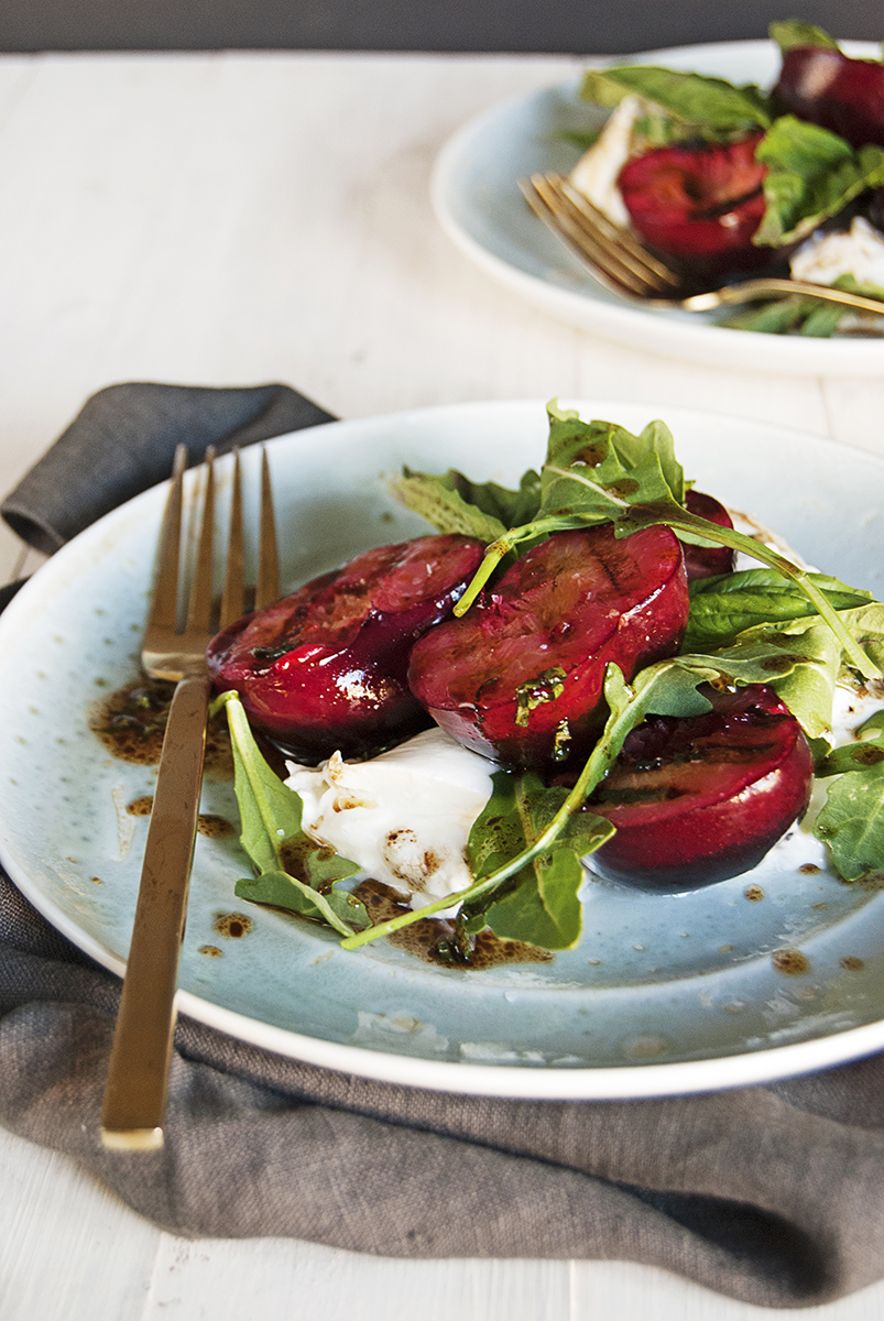 This recipe for grilled plums will be your new go-to summer fruit salad! It features grilled plums, creamy burrata, and a quick balsamic basil vinaigrette.