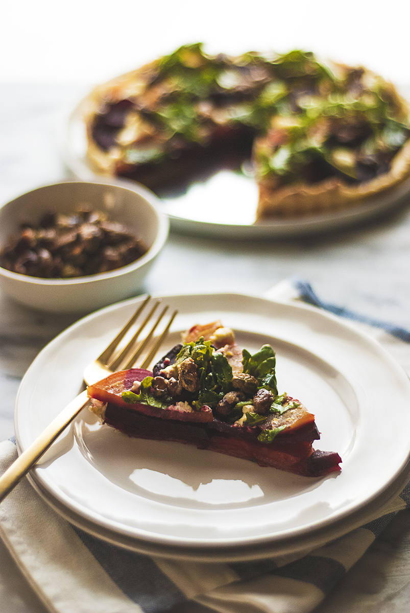 This roasted beet tart makes the perfect fall side dish, with beautiful deep red and golden beets, candied pistachios, goat cheese, and arugula salad.