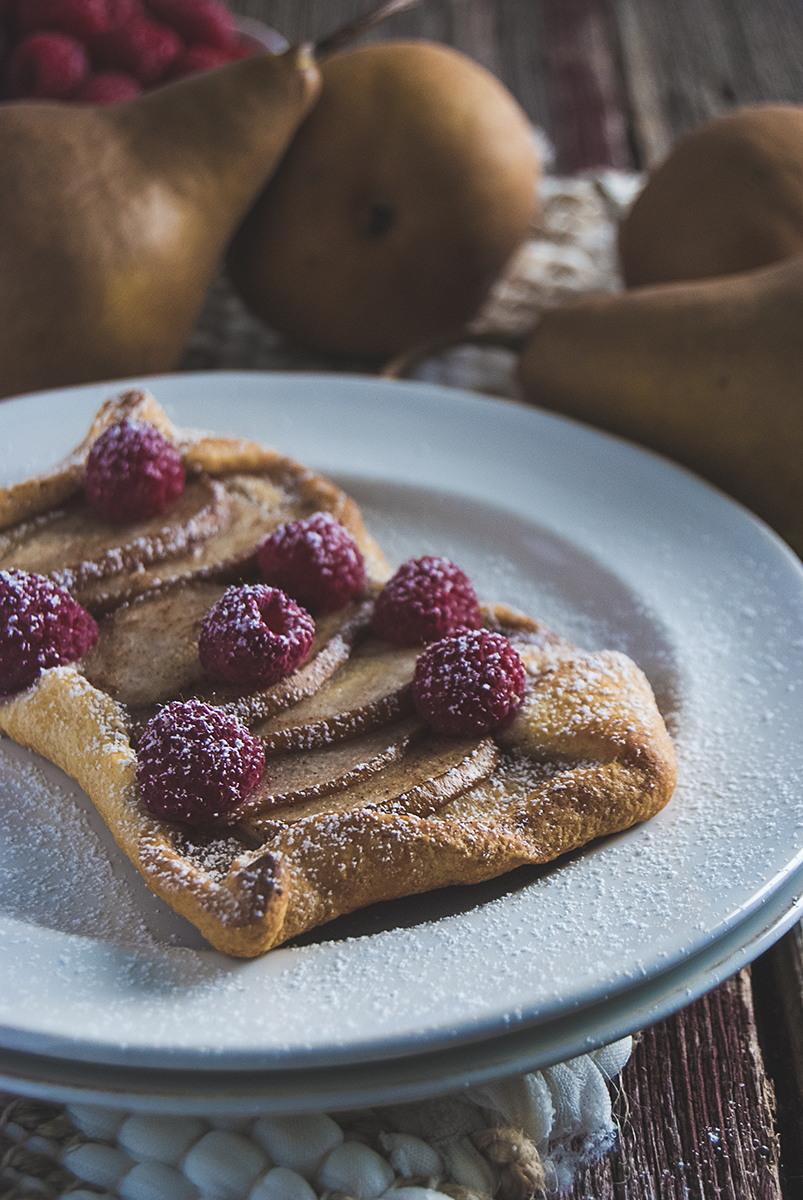 These raspberry and pear turnovers will be your new go-to breakfast recipe! They are made from crescent roll dough and topped with fresh raspberries.
