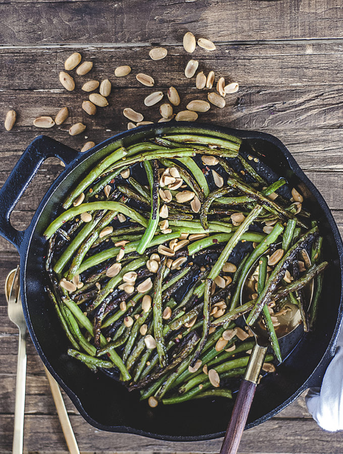 These blistered miso green beans are paired with a spicy glaze made from white miso paste, mirin, sesame oil and rice vinegar and are topped with crushed peanuts.