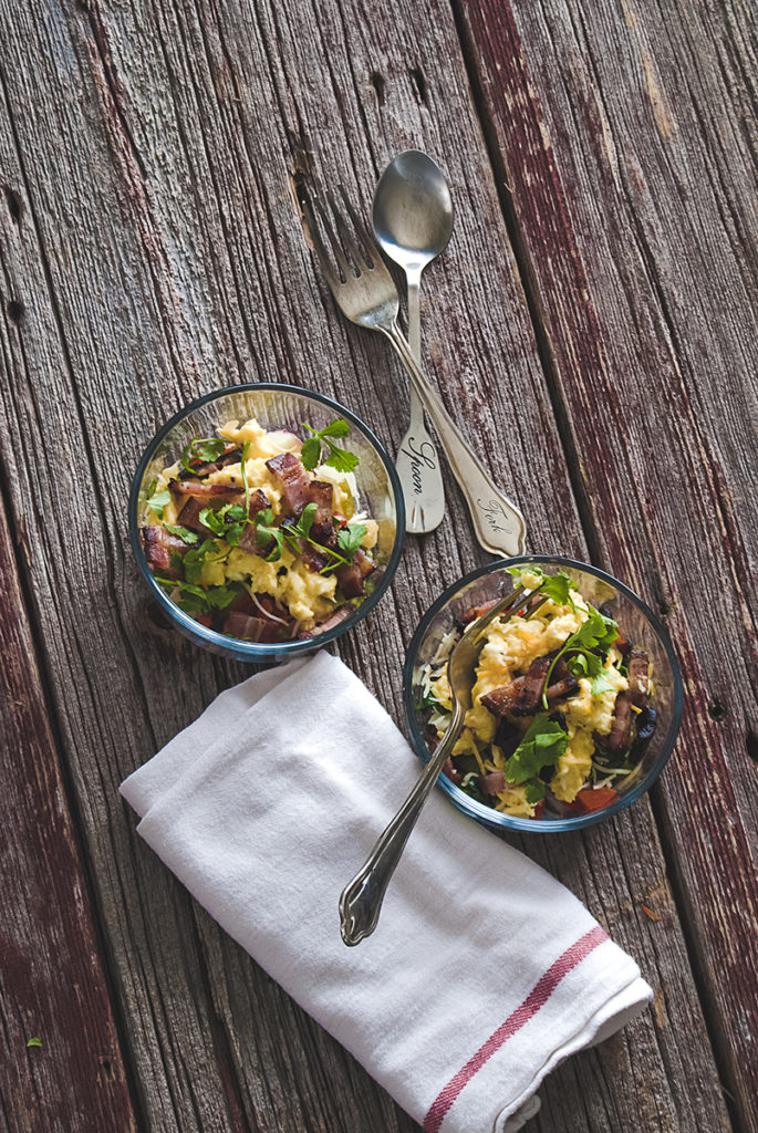 These Mexican egg scrambled egg breakfast bowls are easy to prep in advance, and are packed full of goodies, like bacon, potatoes, sautéedpeppers and onions, Mexican cheese and cilantro!