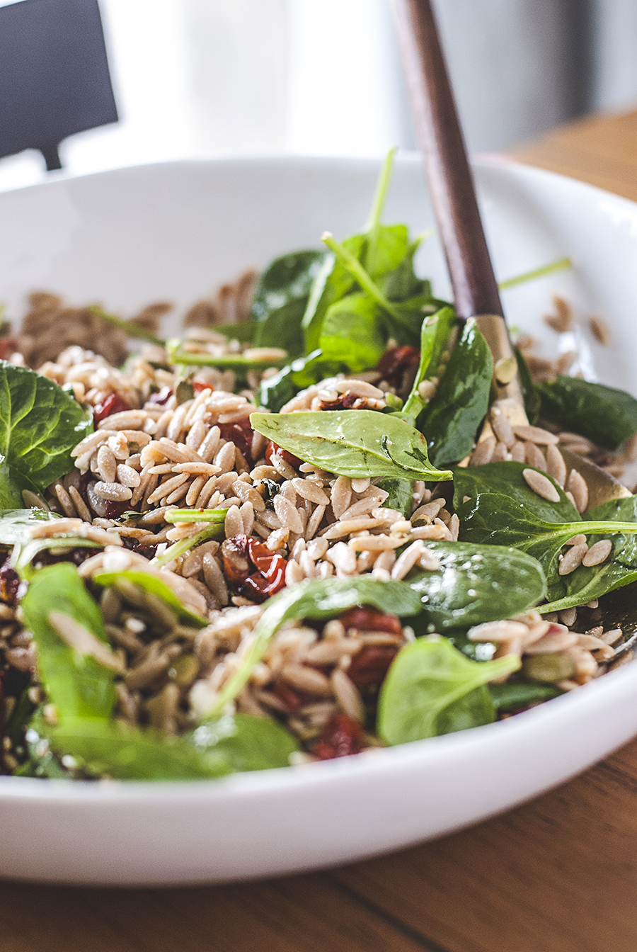 This sun-dried tomato orzo salad features fresh spinach, lots of salty feta and crunchy pepitas, and roasted cherry tomatoes, and is finished with a simple, homemade Italian vinaigrette.