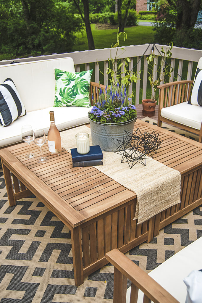 Are you stumped with how to plan your outdoor coffee table decor? See how I used the same principles as indoor coffee tables for this outdoor space!