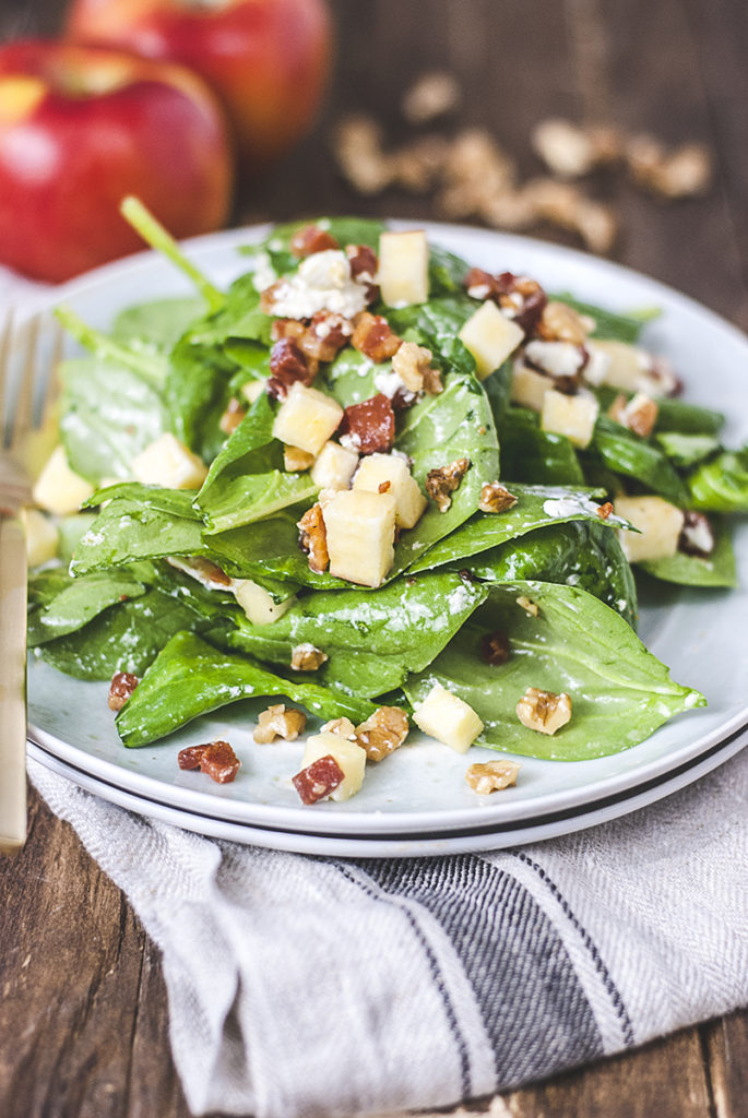 This spinach pancetta salad features crispy pancetta, creamy goat cheese, walnuts, apples and a quick homemade honey champagne vinaigrette.