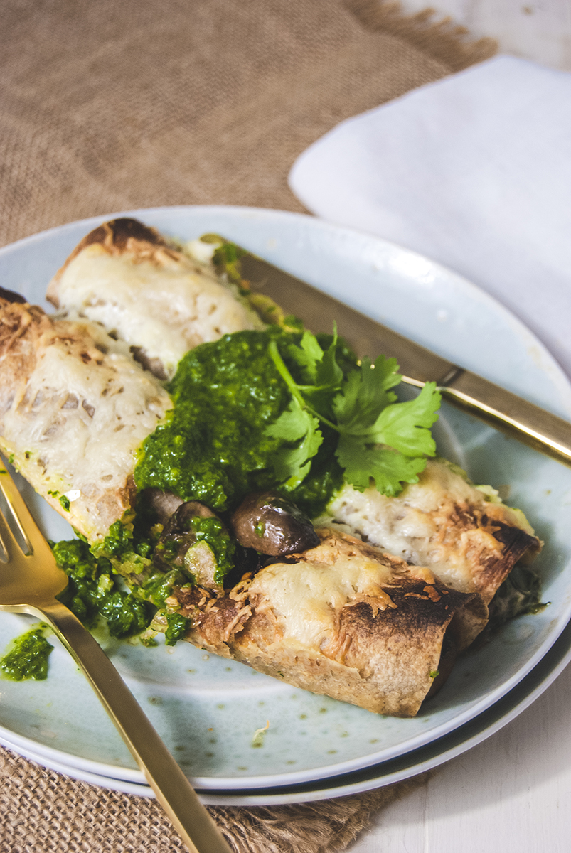 Vegetables are the star in this spinach and mushroom enchiladas recipe, featuring white cheddar and a fresh green chimichurri sauce made from herbs.