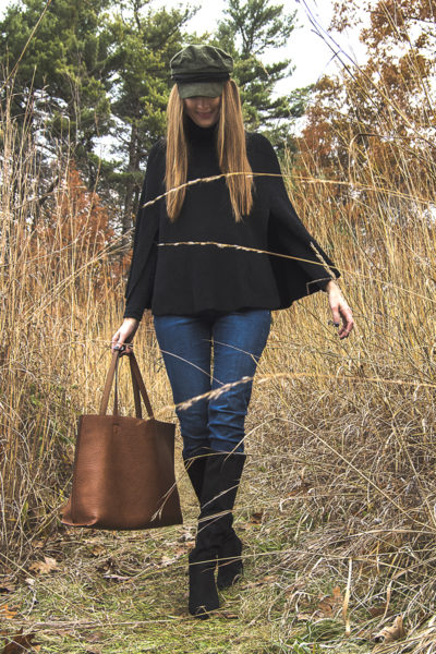 This black sweater cape is the perfect accessory for staying warm this season! Add suede boots and your favorite hat, andit's the perfect winter weekend look!